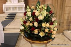 #Church decoration - Champagne and dark red floral arrangement for the altar