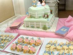 Here is the Beatrix Pottery Baby Shower Cake with Peter Rabbit, Mrs. Rabbit, Jemima Puddle-Duck, and Mr. Jeremy Fisher characters made out of fondant.   There are also cookies on this dessert table of Jemima Puddle-Duck and Peter Rabbit decorated by my mom.