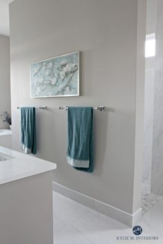 Bathroom with marble floor and shower with Benjamin Moore Balboa Mist, warm gray or greige paint colour. Teal accents.  Kylie M Interiors E-decor services and consulting