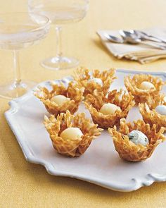 These tiny ice cream cups are ideal for a no-mess refreshing dessert -- or a snack during cocktails. The cups are made on a pizzelle iron, which is available at cookware stores and looks like a flat, decorative waffle iron.