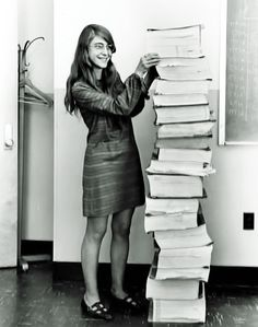 This is Margaret Hamilton. Lead software designer for the Apollo space program. That stack of books she's holding up is the entire source code listings, written in assembly, for the Apollo 11 flight computer's software.