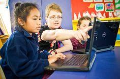 Student with teacher at computer. Effective Teaching, Curriculum, Language, Classroom, Teacher, Student, Community, Education, Resume