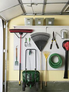 A securely mounted pegboard system will get your tools — rakes, hoses, even wheelbarrows — off the floor and out of the way, plus you'll always be able to see what you have.  Add a shelf above the peg board for extra storage
