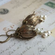 $30 for Tulip earrings? Reminds me of the Secret Garden.  These elements look familiar... oh yes: Vintaj antiqued brass findings. That's probably a fair price, if the maker paid retail for the findings, and then figured in an hourly wage.
