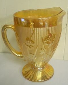 Pattern:   Iris Depression Glass is also known as Iris and Herringbone.  Manufacturer:   Jeanette Glass Company