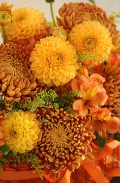 mix of dahlias and chrysanths:  gold Dahlias, bronze Chrysanths and gold alstromeria