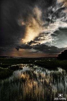 Drifting light and passing clouds over Broad Creek, Hilton Head Island, South Carolina