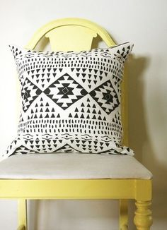 Modern southwest decor. The yellow painted vintage chair and black and white patterned pillow are a fresh take on southwestern decoration.