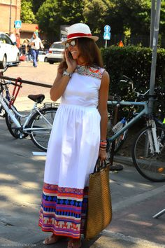 White dress with ethnic details. Viviana Volpicella