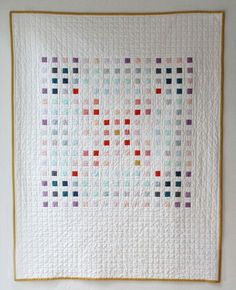 I haven't blogged in a really long time, but I just finished this quilt, which I've been working on slowly for a while. Each (of the 225!) colored squares is one inch. I picked the size…