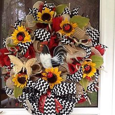This Adorable Rooster Wreath is done with Cream mesh and red and burlap mesh tied in.  Theres Chevron Ribbon tied thru out and a big bow at the