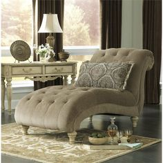 The classical design of this Ashley Parkington Bay Chenille Chaise Lounge is well-suited for anyone who wants to add a touch of elegance and refinement to any room.