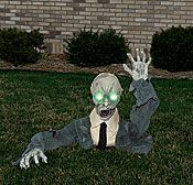 Halloween yard decorations create a scene outside your party or scare trick or treaters. Choose outdoor Halloween decorations including lights, signs, and yard props.