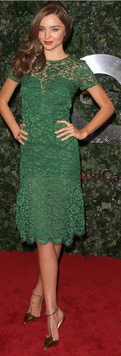 Who made  Miranda Kerr's green lace short sleeve dress and gold pumps that she wore in Beverly Hills on February 22, 2013?