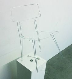 Do Not Touch chair by Dominic Wilcox | move loop through electrified chair frame without touching