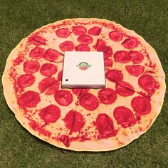 This beach towel will make other beachgoers hungry.  The Pepperoni Pizza  Towel  is an oversized round beach towel that looks. 6bc5c06223