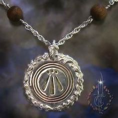 Custom Awen Necklace The Awen is an ancient symbol attributed the the Druids of old. Three Rays used many followers of Druidry; symbolizing Sky Father Energy in balance with the Earth Mother energy. Solid Sterling, inlaid with hand carved amber with open back providing light to shine; emanating from the dots and rays in the center.