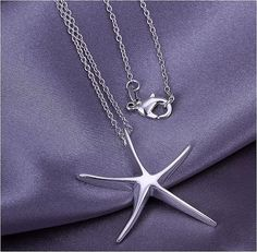 This Etsy seller at least admits this necklace is not 925 sterling silver, but that doesn't stop them from selling cheapie stuff with fake hallmarks.  Visit the Etsy listing to see the 925 mark on the underside of the starfish.