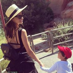 The happiest place on earth! Miranda Kerr holds hands with her little boy Flynn as they sp...