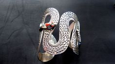 omg. this is so amazing. Silver Snake Cuff by TezoroAzul on Etsy