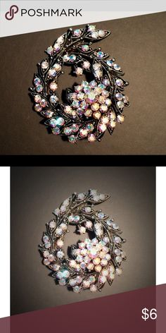 Vintage Style Brooch With a vibrant, opalescent sparkle, this brooch would look beautiful on a spring jacket or even tucked inside your wedding bouquet. Jewelry Brooches