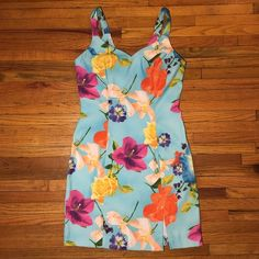 Host Pick  Sweetheart 1990's Floral Dress HOST PICK ✨Top Trends Party 04/23/2016✨ Day to Evening Dress is More Beautiful, Colorful in Person!  Perfect for Hawaiian Themes!  This is Retro Dress was Purchased in the 1990's!  It's Sweetheart Neckline, Snug-to-Body Stretch Material, Vivid Multi-Floral Makes it a Head-Turner!  Barely Worn 1 X, in Like-New Condition!  Tag States Size 6 But it Fits Smaller More Like a 4-5 in My Opinion.  Material is 97% Polyester/3% Spandex. Dawn Joy Dresses
