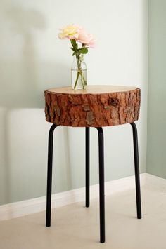 We love the rustic-meets-industrial appeal of this log slice accent table. Did we mention the IKEA stool being used here retails for $6?