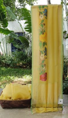 This daffodil yellow coloured Benares kora has a side panel of jamdani work and silver zari. The border has a hint of olive green and silver zari while the pallu too has silver zari work giving it …