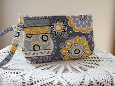 Wristlet Zipper Gadget Purse Pouch in Dots in Funky Flowers in Gray. $11.99, via Etsy.