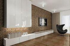 écran plat mural dans le salon avec mur d'accent en brique, module mural blanc et meuble TV bas blanc