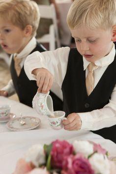 Mannerly, young gentlemen enjoying afternoon tea / Chantilly High Tea Catering