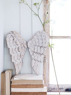 Carved Angel Wings by Cox and Cox. Milly has had these above her bed since she was born. Beautiful piece.
