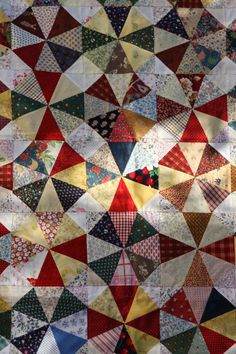 Kaleidoscope Quilt Top by http://quiltingstories.blogspot.com/2014/06/kaleidoscope-quilt-Top-scraps-red-sashing-.html