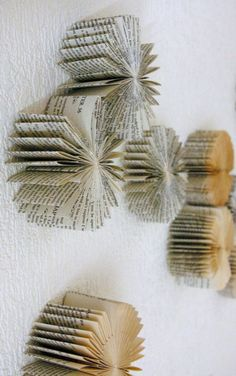 books turned to wall art--the books are sliced up & pages folded in half toward the center