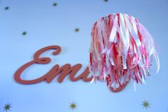 Easy DIY Coral, Pink and Gold Nursery Mobile, made with ribbon.