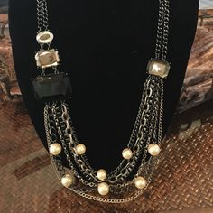 SALE Black and Pearl Necklace Looks great with dark colors! Worn a few times. Looks really cute with work outfits too. Wet Seal Jewelry Necklaces