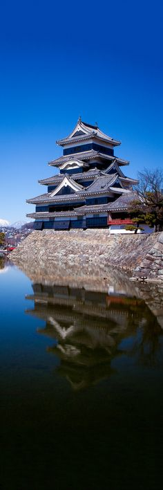 Matsumoto Reflected - Matsumoto Castle on a clear spring day. Nagano, Japan