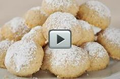 Mexican Wedding Cake cookies - I eat them w/o the nuts in the middle but they are one of the best cookies I've ever put in my mouth! Mexican Wedding Cake Recipe, Mexican Wedding Cake Cookies, Mexican Cookies, Baking Recipes, Cookie Recipes, Snack Recipes, Cookie Ideas, Baking Ideas, Cupcake Recipes