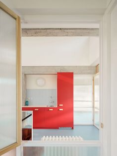 Throughout the interiors, Azab combined the farmhouse's exposed concrete frame and lightly painted walls with flourishes of bright colour, mirrors and striped glass. Spanish Architecture, Contemporary Architecture, Interior Architecture, Interior Design, Upper House, Concrete Interiors, Exposed Concrete, How To Level Ground, Open Plan