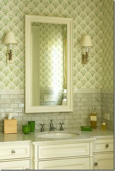 Wallpaper fits well in small bathrooms.  May try this small backsplash in our bathroom.  Also like the mirror hung vertical since we don't have a full-length