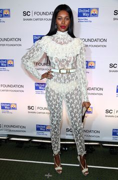 Model Jessica White wears a lace see-through jumpsuit at the Jay-Z Concert To Benefit The United Way Of New York City And The Shawn Carter Foundation at Carnegie Hall on February 2012 in New York City. Fashion Group, Fashion News, Fashion Trends, Latest Celebrity Gossip, Celebrity Style, White Party Attire, Jessica White, Garter Belt And Stockings, High Fashion Dresses
