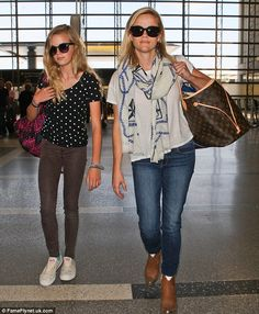 What a difference a vacation makes: Reese was looking tired and weary on May 31 when she left LAX with Ava, bound for Paris