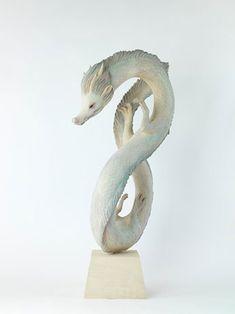 Tsuchiya Yoshimasa's wood sculpture inspired by Japanese fantasy creatures.