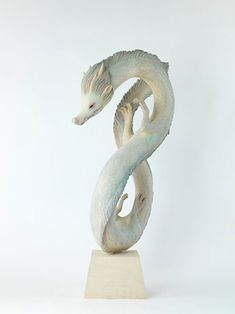 Tsuchiya Yoshimasa's wood sculpture inspired by Japanese fantasy creatures.