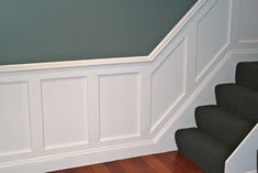 Wainscoting Ideas with grey wall and dark stairs plus wooden floor
