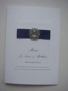 Wedding Menu card with a cameo embellishment and satin ribbon in navy blue