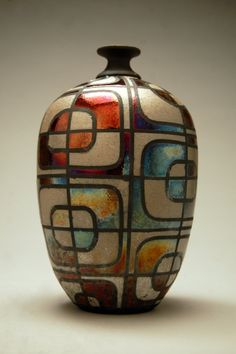 This vase was thrown on the potters wheel by Ryan Peters in his studio in Historic Downtown Waukesha. He finished this piece by applying a pattern to
