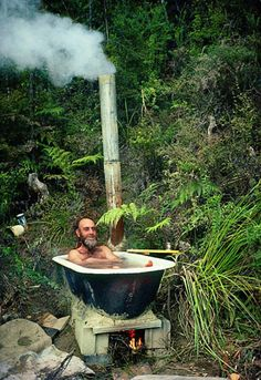 Gerd Ludwig phot. of European artist Friedensreich Hundertwasser at his New Zealand home bath.