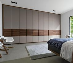 Luxury made-to-order wardrobes shown in walnut and glass
