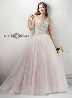 Gorgeous tulle ballgown, Whitney Marie by Sottero and Midgley, exudes romance. Finished with Swarovski crystals and voluminous tulle skirt.